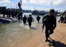 Filipino soldiers disembark from the landing ship before they dock at Motiong Beach during the Humanitarian Assistance and Disaster Response scenario during the Philippines and United States annual Balikatan (Shoulder-to-Shoulder) exercises